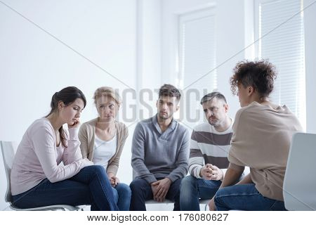 Group Supporting Sad Woman