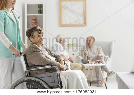 Nurse And Disabled Woman