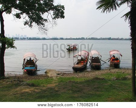 Boats on the banks of the Yangtze River Wuhan China