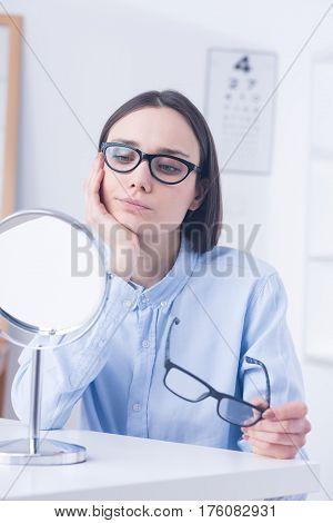 Undecided Client Choosing Eyeglasses
