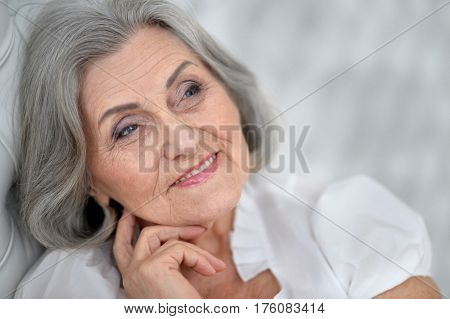 Portrait of a beautiful happy elderly woman closeup