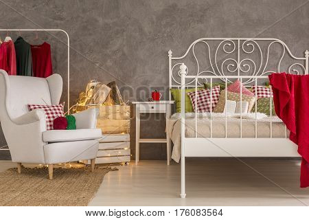 Bedroom With Armchair And Bed