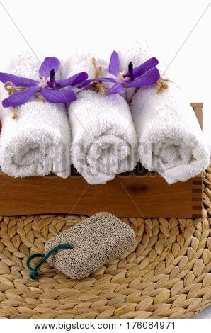Spa setting with orchid ,towel, brush mat texture