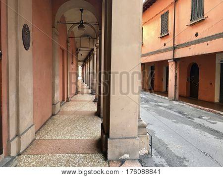 Narrow city street view traditional architectural features in Bologna, Italy