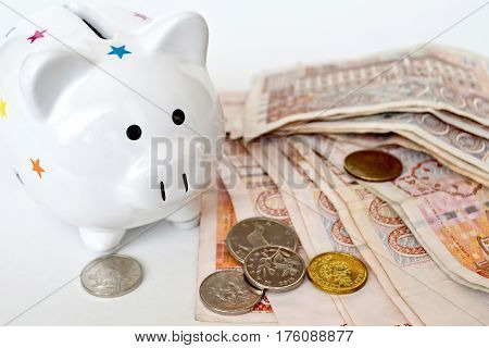 Piggy bank and Croatian banknotes on light background