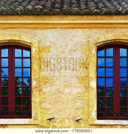 The long wooden French Windows without Shutters