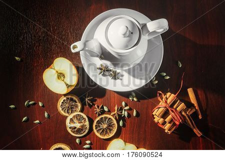 Tea cups with teapot on old wooden table. Fruit ginger hot drink. On top view.