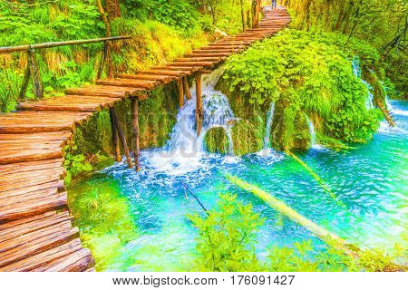 Deep forest cascades and tourist path in Plitvice lakes national park Croatia.
