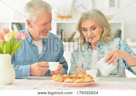 Portrait of a beautiful elderly couple having breakfast