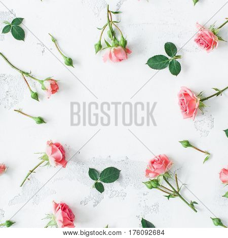 Flowers composition. Frame made of rose flowers. Flat lay top view