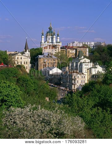 Andriyivskyy Descent and the Saint Andrew's Church with blossom trees in foreground. Kiev.