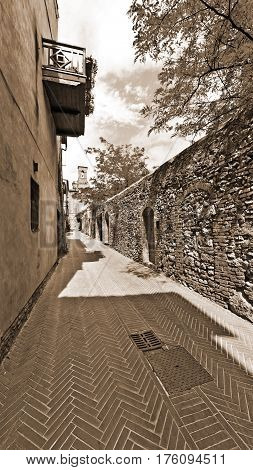 Street in the Medieval City of Gimignano in Italy Vintage Style Sepia