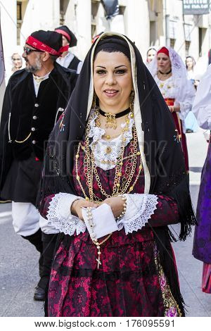 CAGLIARI, ITALY - May 1, 2016: 360 Feast of Saint Efisio - portrait of a beautiful woman in traditional Sardinian costume - Sardinia