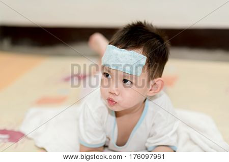 The Kid Attach Cooling Gel Pad On His Forehead
