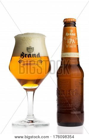 GRONINGEN, NETHERLANDS - MARCH 12, 2017: Bottle and glass of Dutch Brand IPA beer isolated on a white background