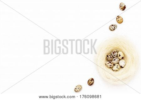Easter Quail Eggs In A Nest And Some Eggs On A Near White Background.