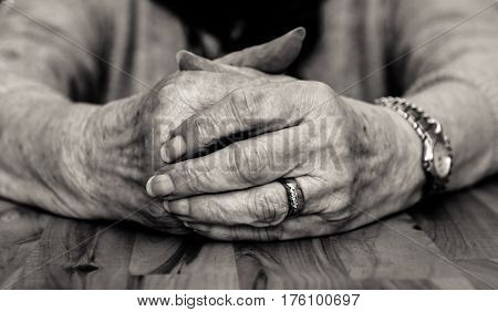 Black And White Image Of Old Lady's Clasped Hands.