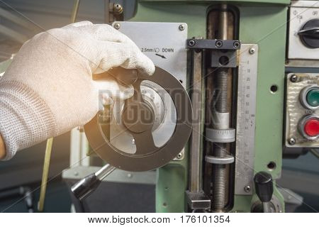 Hand Of Man Using Milling Machine.