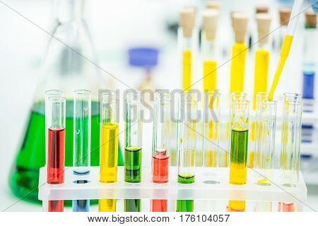 Close-up view of test tubes with reagents in chemical laboratory