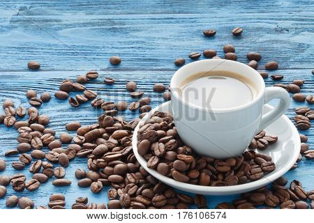 Cup Of Coffee On Turquoise Wooden Table