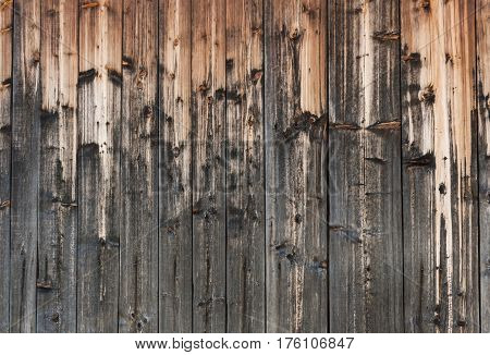Wood background of old beautifully painted with time and natural precipitations planks.
