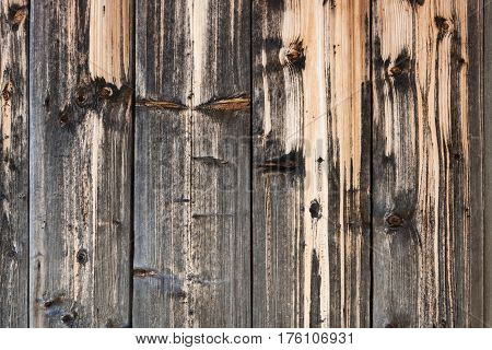 Wood background. Close-up old beautifully discolored from time and natural precipitations planks.