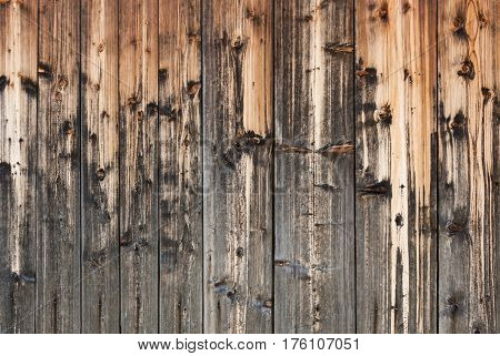 Wood background of old beautifully discolored from time and natural precipitations planks.