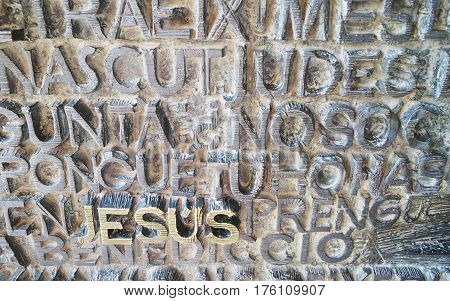 BARCELONA SPAIN - OCTOBER 08 2015: JESUS name at the main door of the Basilica of the Sagrada Familia designed by famous architect Antoni Gaudi and located in Barcelona Spain
