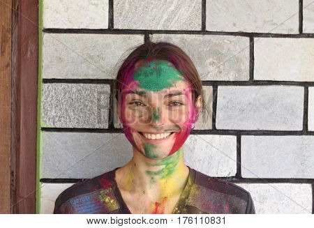 Young beautiful woman after Happy Holi festival