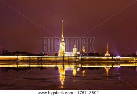 Peter and Paul Fortress at night in cloudy weather in St. Petersburg.