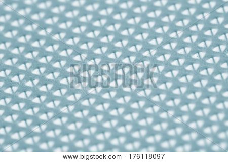 horizontal detail of industrial aluminum metal blue background texture with embossed bumps and selective focus