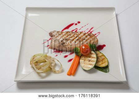 Pork Medium Rare With A Side Dish Of Grilled Zucchini Flavored Cranberry Sauce