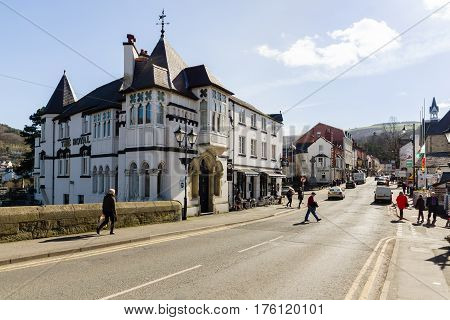 Llangollen Wales UK - March 9 2017: Llangollen showing the Royal Hotel and Castle Street the town is a major gateway into North Wales and a crossing point over the River Dee