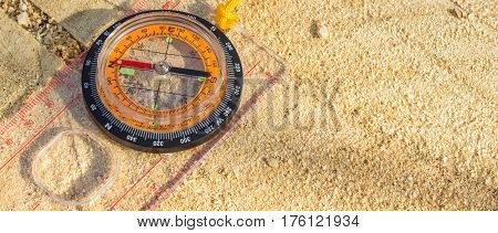 Compass on the stump this device allows you to navigate in an unfamiliar terrain its arrow always points to the north this allows you to choose the right direction in the hike to the example