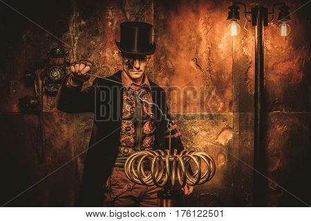 Steampunk man with Tesla coil on vintage steampunk background.
