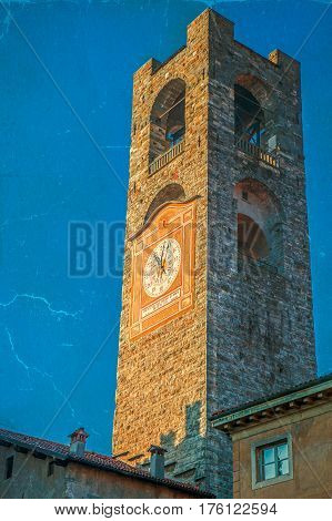 Old photo with Civic Tower (Torre Civica Campanone) in CItta Alta (old town) of Bergamo Lombardy Italy.