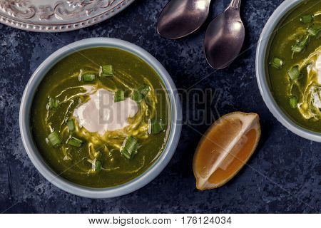 Bowls With Green Soup Of Broccoli, Spinach