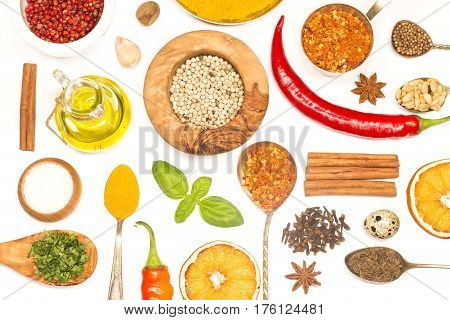 Various herbs and spices on white wooden background