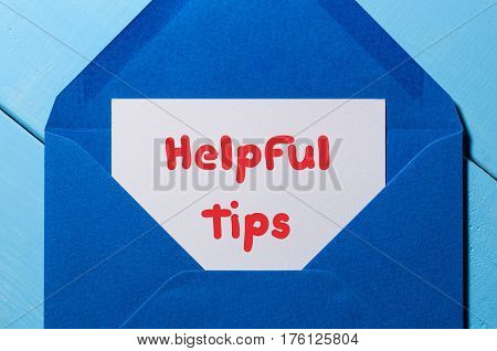 Helpful Tips, Business Concept, text written at mail in blue envelope