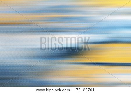 Blue yellow horizontal motion blur background photo