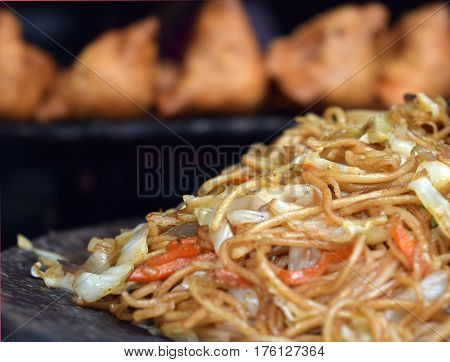 street food is ready to eat food or drink sold by a hawker or vendor in a street or other public place . it is often sold from a portable food booth food cart or food truck and meant for immediate consumption .