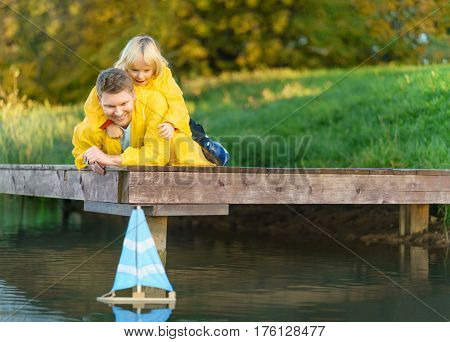Family with a ship at lake
