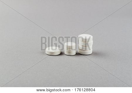 Towers from pills - rising of taking pills. Medical concept.