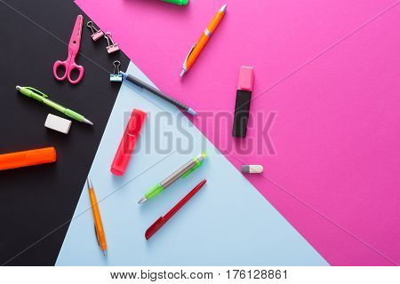 Stationery supplies and devices -  top view flat lay mockup of creative work space at modern office with markers, rubbers, pens, scissors and binder clips, nobody, objects, copy space