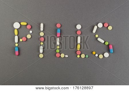 Word created from colored pills. Medical concept.