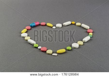 Heart created from colored pills. Medical concept.