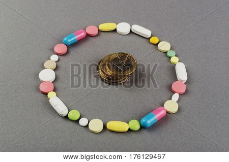 Circle created from colored pills with money. Medical concept.