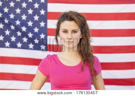 portrait of a charismatic caucasian american woman isolated on a U.S.A. flag