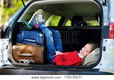 Adorable Little Girl Ready To Go On Vacations With Her Parents. Kid Relaxing In A Car Before A Road