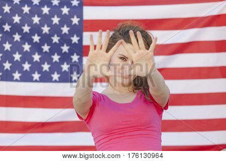caucasian young american beautiful woman isolated against a U.S.A. flag